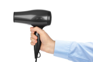 Hair dryer in hand