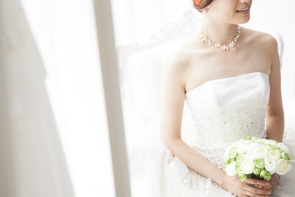 Bride sitting with a bouquet in the waiting room